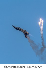 TORRE DEL MAR, MALAGA, SPAIN-JUL 30: Aircraft F-16 Belgian solo display taking part in a exhibition on the 1st airshow of Torre del Mar on July 30, 2016, in Torre del Mar, Malaga, Spain