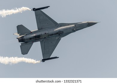 TORRE DEL MAR, MALAGA, SPAIN-JUL 28: Aircraft F-16 Belgian solo display taking part in a exhibition on the 2nd airshow of Torre del Mar on July 28, 2017, in Torre del Mar, Malaga, Spain