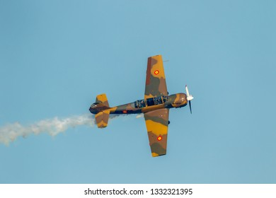 TORRE DEL MAR, MALAGA, SPAIN-JUL 29: Aircraft Yakolev Yak-52 of Salva Ballesta taking part in a exhibition on the 2nd airshow of Torre del Mar on July 29, 2017, in Torre del Mar, Malaga, Spain