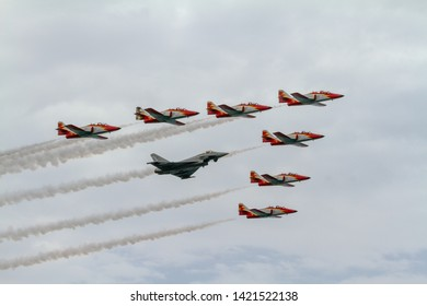 TORRE DEL MAR, MALAGA, SPAIN-JUL 31: Aircraft of the Patrulla Aguila and Eurofighter Typhoon EF-2000 taking part in a exhibition on the 1st airshow of Torre del Mar on July 31, 2016, in Torre del Mar