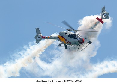 TORRE DEL MAR, MALAGA, SPAIN-JUL 14: Patrulla Aspa, Helicopter Eurocopter EC-120 Colibri taking part in a exhibition on the 4th airshow of Torre del Mar on July 14, 2019, in Torre del Mar,Malaga,Spain
