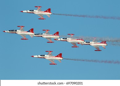 TORRE DEL MAR, MALAGA, SPAIN-JUL 29: Aircraft Northrop F-5 of the Turkish Stars  taking part in a exhibition on the 2nd airshow of Torre del Mar on July 29, 2017, in Torre del Mar, Malaga, Spain