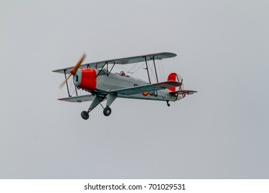 TORRE DEL MAR, MALAGA, SPAIN-JUL 31: Airplane CASA Bucker 1.131E Jungmann taking part in a exhibition on the 1st airshow of Torre del Mar on July 31, 2016, in Torre del Mar, Malaga, Spain