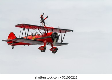 TORRE DEL MAR, MALAGA, SPAIN-JUL 31: Wingwalker Danielle on the Aircraft Boeing Stearman taking part in a exhibition on the 1st airshow of Torre del Mar on July 31,2016,in Torre del Mar, Malaga, Spain