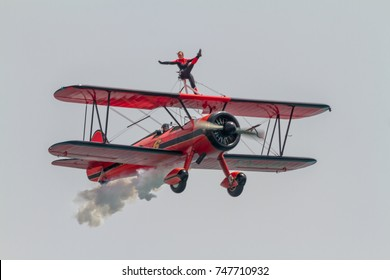 TORRE DEL MAR, MALAGA, SPAIN-JUL 30: Wingwalker Danielle on the Aircraft Boeing Stearman taking part in a exhibition on the 1st airshow of Torre del Mar on July 30,2016,in Torre del Mar, Malaga, Spain