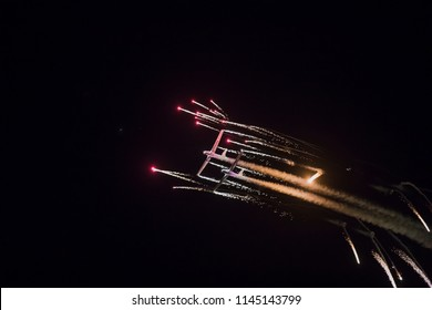 TORRE DEL MAR, SPAIN - July 28, 2018: Aerosparks planes performing night airshow in the night with fireworks at Torre del Mar International Airshow in Malaga, Spain.