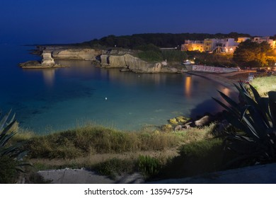 TORRE DELL ORSO ITALY ON AUGUST 2018: The most beautiful coast of Apulia: Torre Dell'Orso Bay in Puglia Italy. St Andrea beach by twilight