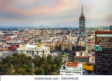 Torre Latinoamericana on Juarez avenue and morning sun flare, Mexico city capital. Aerial view of Mexico city