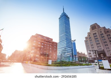 Torre Latinoamericana on Juarez avenue and morning sun flare, Mexico city capital