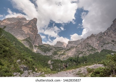 Torre Trieste, the finest & stunning mountain tower, at the south end of Civetta group, as seen from Alta Via1 trail down to Listolade village from Vazzoler refuge, eastern Dolomites, Italy