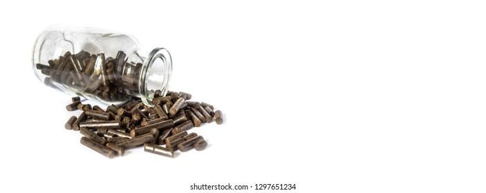 Torrefied wood pellets in a glass