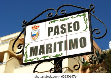 TORREMOLINOS, SPAIN - SEPTEMBER 3, 2008 - Ceramic Paseo Maritimo street sign in a wrought iron frame, Torremolinos, Malaga Province, Andalusia, Spain, Western Europe, September 3, 2008.
