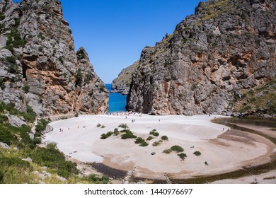 Torrent de Pareis Sa Calobra Mallorca, Spain. Beautiful bay beach turquoise sea mountains, Cala Sa Calobra.