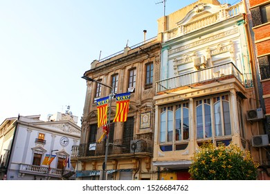Torrent, Valencia, Spain - October 9, 2019: Festive day in Valencia. Buildings views from Plaça Colom and Plaça Major in Torrent. Town Hall from  Torrent.