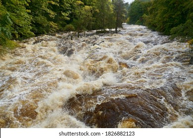 Torrent of water flowing down the river Feugh