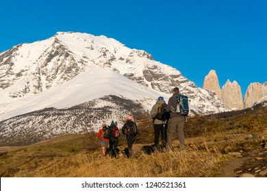 Torres del Paine, Chile - Sep 27, 2018: Tourists start hiking up to Mirador Las Torres in Torres del Paine national park of Chile in the early morning