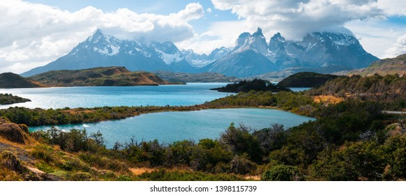 Torres del Paine National Park with snow capped mountains (Cordillera Paine) and the lake of Pehoe during sunny and windy weather. Chile