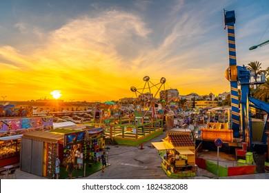 Torrevieja, Alicante / Spain »; September 12, 2020: Amusement park at sunset in the coastal town of Torrevieja, Alicante, Valencian Community. Spain, Mediterranean Sea