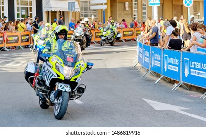 Torrevieja, Spain - August 24, 2019: Police control safety of bike riders and spectators during La Vuelta sports competition leading international cycling race, starting in Torrevieja in 2019, Spain