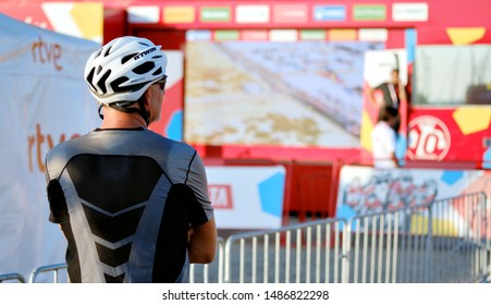 Torrevieja, Spain - August 24, 2019: Rear view unrecognizable sportsman or just spectator during popular competition La Vuelta, one of the leading international cycling races starts in Torrevieja