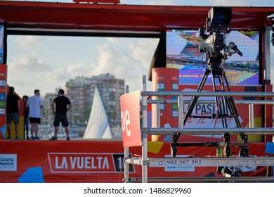 Torrevieja, Spain - August 24, 2019: Television broadcasting La Vuelta competition international poplar sportive event shown big screen outdoors, Torrevieja city, Spain