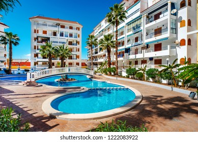 Torrevieja, Spain - February 25, 2016: Typical spanish residential houses summer townhouses with swimming pool.  Alicante province, Spain