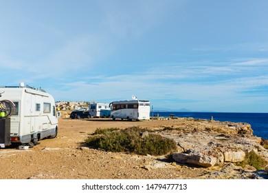TORREVIEJA, SPAIN - JANUAR 28, 2019: Camper vans recreational vehicles on mediterranean coast of Torrevieja seaside spanish city on the Costa Blanca, on Januar 28, 2019, Spain