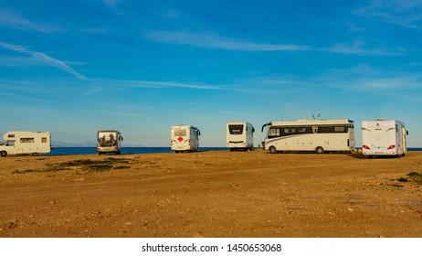 TORREVIEJA, SPAIN - JANUAR 30, 2019: Campers, motorhomes and recreational vehicles on mediterranean coast of Torrevieja seaside spanish city on the Costa Blanca, on Januar 30, 2019, Spain