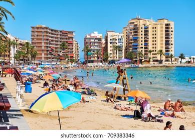 Torrevieja, Spain - July 10, 2017: Coastline of Playa del Cura in Torrevieja city at summertime. Costa Blanca. Spain