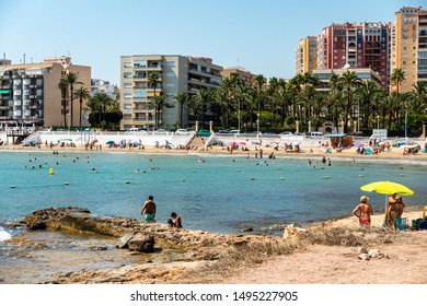 Torrevieja, Spain - Sept 03 2019 : 'Los Locos' beach at the north end of Torrevieja on a hot summers day.