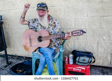 Torrevieja, Spain - Sept. 23 2018 :  Merlin busking with Guitar outside Carrefour store