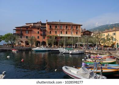 Torri del Benaco, Lake Garda, Italy - June 2, 2010:  Boats by day in the small harbor in the village of Torri del Benaco at lake Garda.