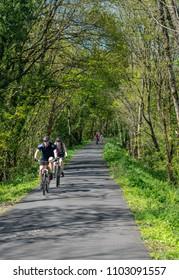 TORRINGTON, DEVON, UK - MAY 6, 2018: Couple riding cycles on the Tarka Trail in North Devon