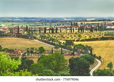 Torrita, Italy - July 22, 2017: Picturesque Tuscany landscape with rolling hills, valleys, fields, cypress trees. Valley Val d'Orcia, Italy. Europe. Vacation, travel, nature concept.