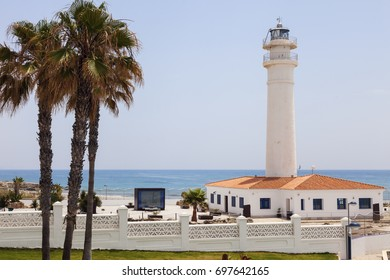 Torrox Lighthouse and blue sky. Torrox, Andalusia, Spain.