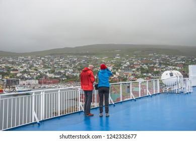 Torshavn / Faroe islands - 8.5.2015: Smyril Line cruise ship and cargo is landing in the port of capital Torshavn at foggy morning