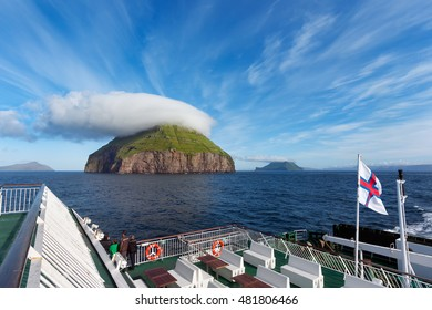 Torshavn, Faroe Islands - June 6, 2011 : Passengers ferry in front of Litla Dimun Island on the route from Torshavn to Suduroy, the southernmost island of the archipelago