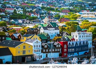 Torshavn, Faroe – July 11, 2018  Vestaravag bay and Torshavn old quarters with quayside buildings, Faroese island of Streymoy