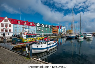 Torshavn, Faroe – July 11, 2018  Vestaravag harbor in Torshavn with its boats, yachts and colorful quayside gabled buildings, Faroese island of Streymoy