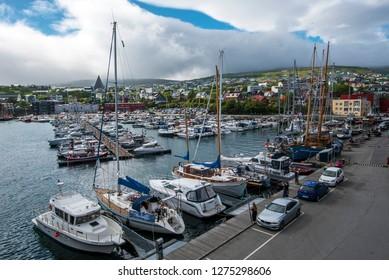 Torshavn, Faroe – July 11, 2018 Vestaravag harbor and Torshavn cityscape, in Faroese island of Streymoy