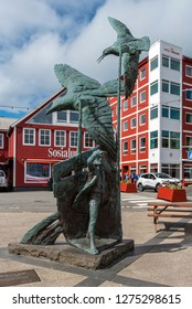 Torshavn, Faroe – July 11, 2018  Trappan place in Torshavn cily center, the monument in the center and the hotel building is at background