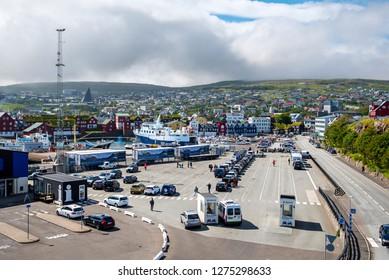 Torshavn, Faroe – July 11, 2018   Ferry terminal of the Port of Torshavn, cars and tacks waiting for boarding