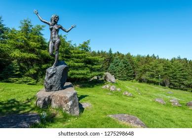 Torshavn, Faroe – July 11, 2018   Statue in memory of William Heinesen by Hans Pauli Olsen in Vioarlundin Park,  Torshavn, Faroese island of Streymoy