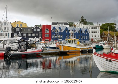TORSHAWN, FAROE ISLANDS, DENMARK - AUGUST 21, 2018: Harbour in bay of Torshawn, which is the capital city of Faroe Islands, Denmark.