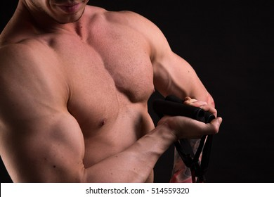 torso of bodybuilder in black studio
