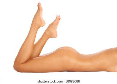 Torso, bum and legs of slim tanned sexy naked woman lying on white background