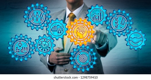 Torso of businessman selecting artificial intelligence on a cogwheel in a gear train full of manufacturing operations icons. Business concept for industry 4.0, AI, virtualization, smooth workflow.