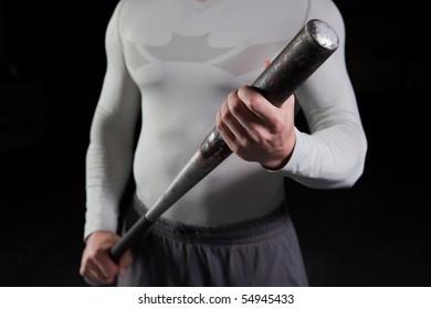 Torso of a guy holding a baseball bat