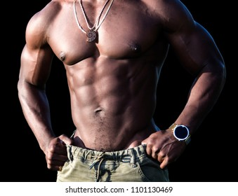 Torso of a handsome muscular shirtless African American man isolated over black background.