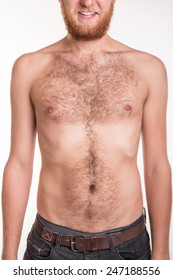 Torso of a man covered with hair - studio shoot